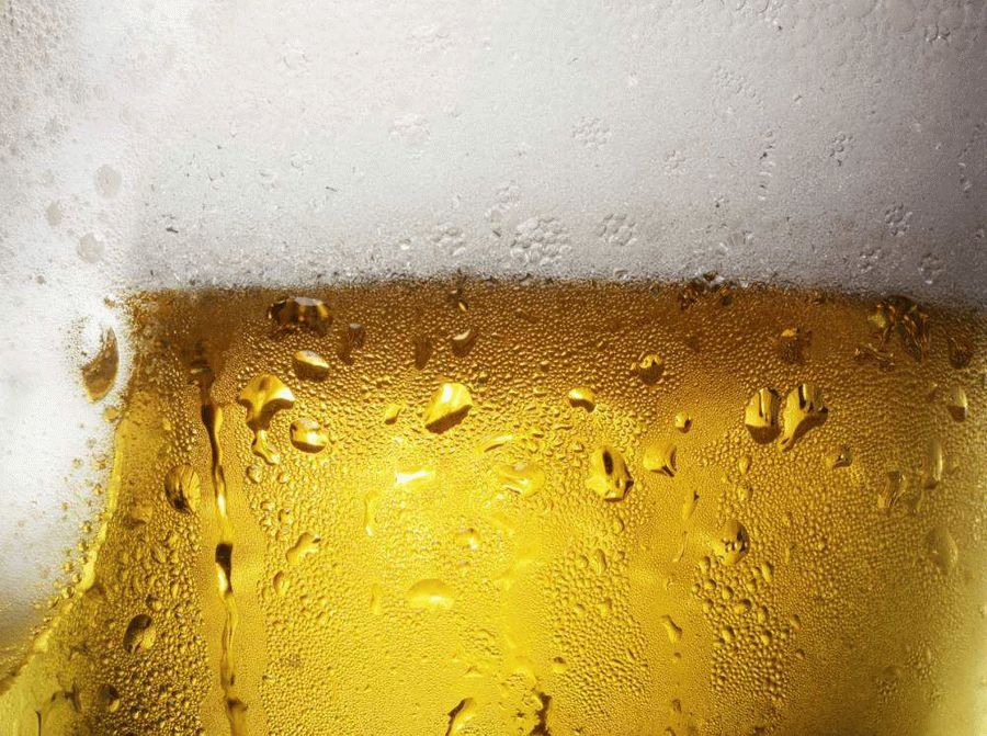 Overfull Glass of Beer with Condensation